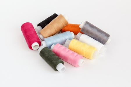multy: Multy coloured bobbins of thread on white background