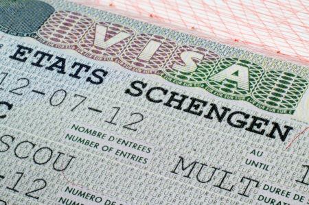 schengen: Close up Schengen visa in the passport