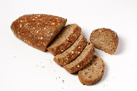 baguet: Slices of rustic herb bread with seeds on white background
