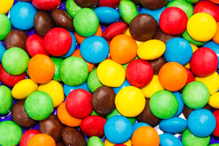 sugarplum: Many colourfull chocolate candy dots for the background