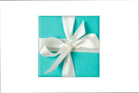 in christmas box: Top view of turquoise isolated gift box with white ribbon on white background Stock Photo