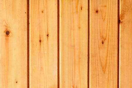 Yellow wall made of wooden planks texture