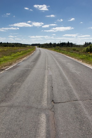 Endless empty asphalt road in Russian suburb