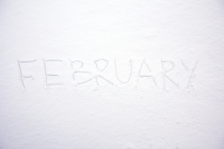 February month hand written text on snow