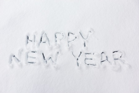 Happy new year handwritten text on snow
