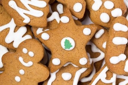 Christmas gingerbread cookies laying on white background