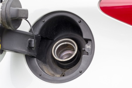 Open petrol cap on car splash board Stock fotó
