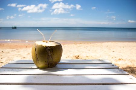 Green fresh coconut on the tropical beach Stock fotó