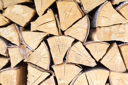 Chopped firewood pieces prepared for boiler background