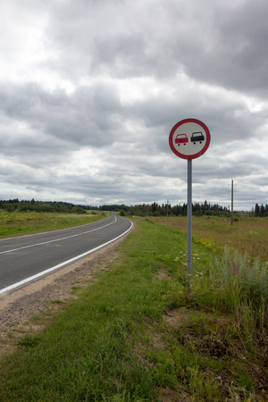 Vertical image of an overtaking prohibited roadsign