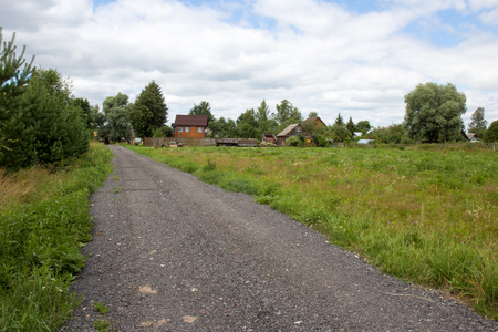 Road to traditional Russian village with meadow Stock fotó
