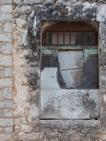 laconia: Closed window of a traditional Greek house