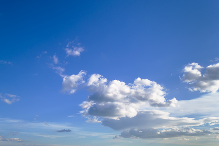 A lot of white scenic clouds high in blue sky on a sunny day, atmosphere skyscape.