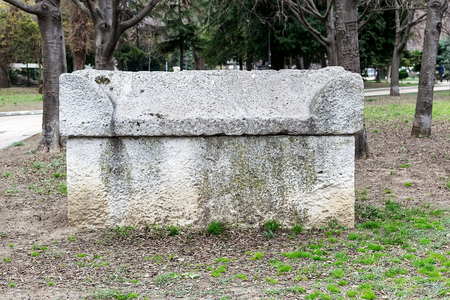 Ancient stone sarcophagus in the park. Antique stone tombs are located in a public park next to the Archaeological Museum in Varna. Tourist attractions and landmarks. Editorial