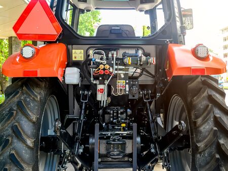 Varna, Bulgaria, June 13, 2019. Rear view of the mechanisms and systems of the tractor, located behind the driver's cab between two large black wheels.