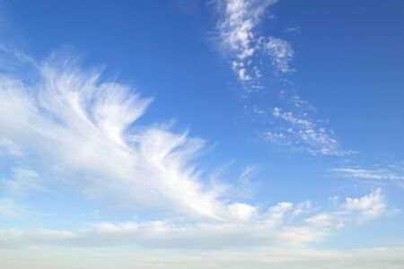 Translucent scenic cirrus clouds high in a blue sky. Cloud species and varieties. Atmospheric phenomena. Skyscape on a sunny day. Beauty in nature.