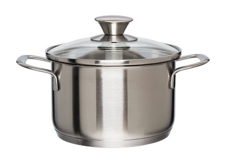 New metal pan with glass lid isolated on white background. Modern kitchen utensils with thick bottom for electric, infrared, induction or gas stoves. Front view.