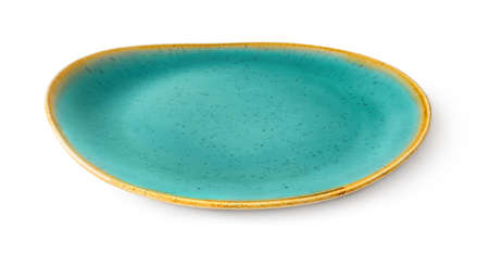 Side view of oval turquoise ceramic plate with yellow border isolated on a white background. Empty crockery for food design. Modern clay, ceramics or porcelain dishes and tableware. Close-up.