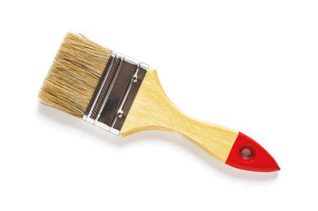 New natural bristle paint brush with red tip wooden handle isolated on white background. Design element for construction painting work, repair and redecorate concepts. Top view. 免版税图像