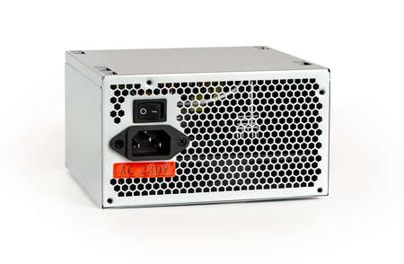 New power supply unit with On Off switch, power cord socket and voltage sticker isolated on white background. Personal computer PSU replacement, hardware equipment concept. Rear view. 免版税图像