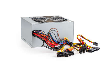 New power supply unit with a lot of colorful wires and connectors isolated on white background. Personal computer PSU replacement, hardware equipment concept. Side view.