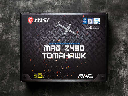 Varna, Bulgaria, January 08, 2021. MSI MAG Z490 TOMAHAWK gaming motherboard box on a dark background. Modern desktop computer hardware components for build and upgrade. Top view. 新闻类图片
