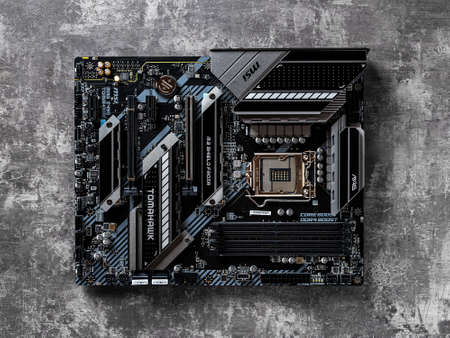 Varna, Bulgaria, January 09, 2021. MSI MAG Z490 TOMAHAWK gaming motherboard on a dark background. Modern desktop PC hardware components for build and upgrade. Top view. 新闻类图片