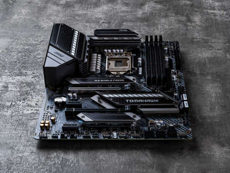 Varna, Bulgaria, January 09, 2021. Gaming motherboard MSI MAG Z490 TOMAHAWK on a dark background. Modern desktop PC hardware components for build and upgrade. Front view.
