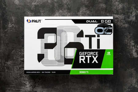 Varna, Bulgaria, January 08, 2021. Palit Nvidia Geforce RTX 3060 Ti Dual OC 8GB gaming graphics card box on a dark background. Modern desktop computer hardware components for build and upgrade. Top view.
