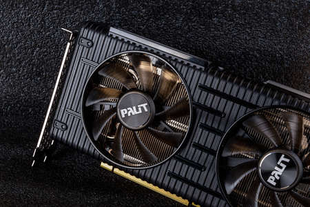 Varna, Bulgaria, January 06, 2021. Palit Nvidia Geforce RTX 3060 Ti Dual OC 8GB GDDR6 gaming graphics card against dark background. Modern desktop computer hardware components for build and upgrade. Top view. 新闻类图片