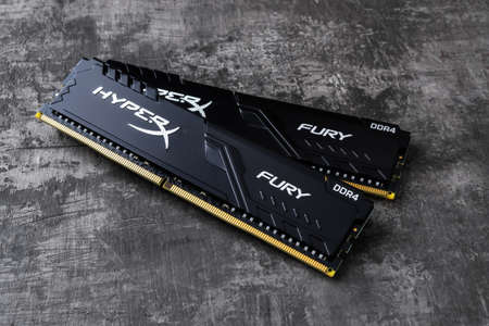 Varna, Bulgaria, January 11, 2021. Two ram memory modules Kingston HyperX Fury DDR4 on a dark background. Modern desktop computer hardware components for pc build and upgrade.