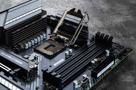 Varna, Bulgaria, January 08, 2021. MSI mag Z490 Tomahawk gaming motherboard with open cpu socket lever on a dark background. Modern desktop computer hardware components for build and upgrade.