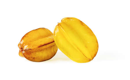 Two whole star fruits or carambola, ripe and overripe isolated on white background. Ingredient for cocktails, salads and fruit desserts. Tasty vegetarian food and vitamin low calorie healthy eating. Front view.