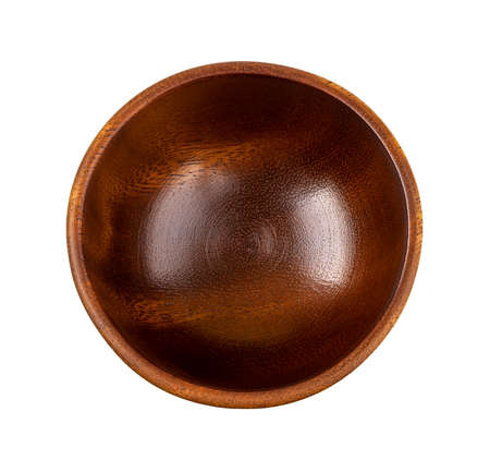 Top view of brown wooden bowl isolated on white background. Empty dishes for food design. Beautiful eco-friendly tableware made of natural wood. Living green lifestyle. Close-up. 免版税图像