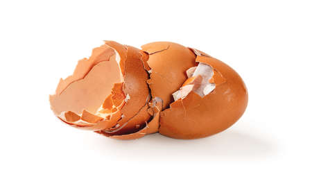 Empty broken eggshells isolated on a white background. Halved shells of brown chicken eggs close-up. Food product high in protein and natural calcium. Food waste and peelings. Front view.