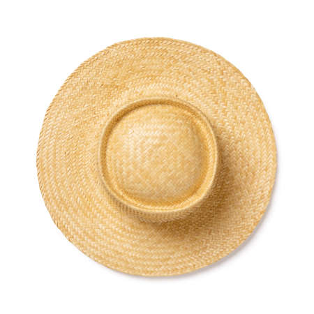 Yellow wide brimmed straw hat isolated on white background. Design element for modern eco-friendly accessory for beach, vacation and travel. Summer vintage classic straw hat. Top view.