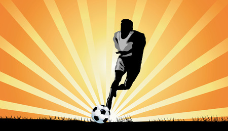 �back ground�: Footballer kicking on ball  with bright light beams on back ground