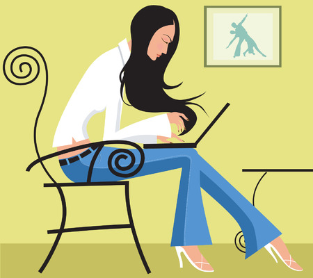 A lady with blue jeans and white top on a table typing on a laptop