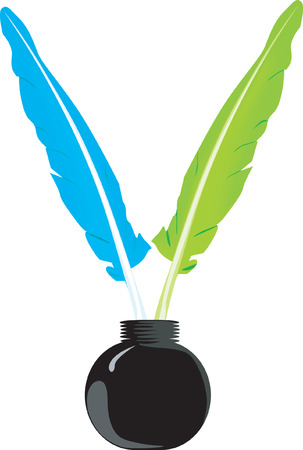 ink pot: Beautiful quills   in an ink  bottle.