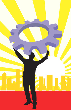 a man lifting a machine wheel in background of silhouette of buildings