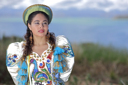 Bolivian woman in traditional costume at Lake Titicaca near Huatajata