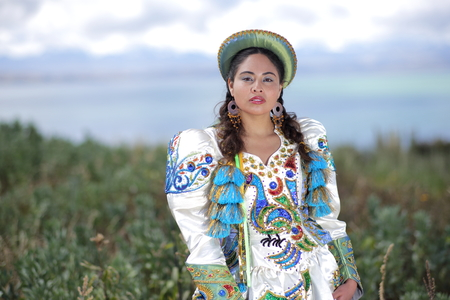 Bolivian woman in traditional costume on the island of Intja near Huatajata, Bolivia
