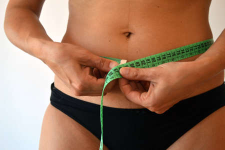 circumference: Measure the waist circumference. Concept. Lose weight.