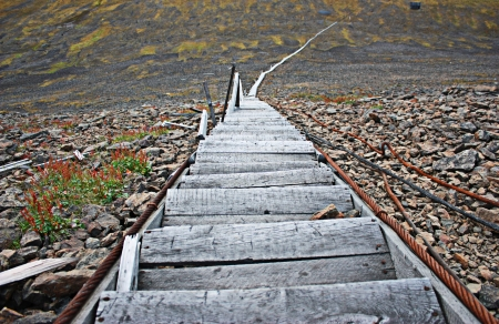 Wooden ladder leaving far down to the hill bottom Stock Photo - 16901326