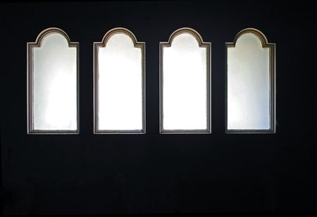 Arched lites with frosted glass panes in a door; vintage c. 1900.  Stock fotó