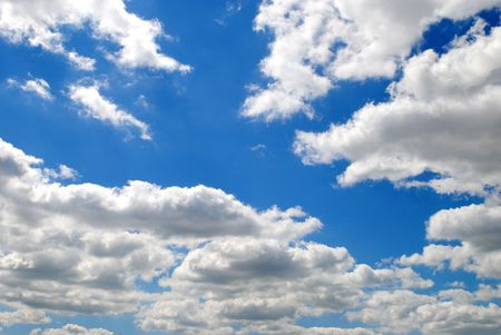 blue sky with bright cumulus clouds edged in silvery-white Stock fotó