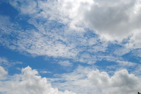 cirrocumulus and cumulus clouds in a bright blue sky Stock fotó