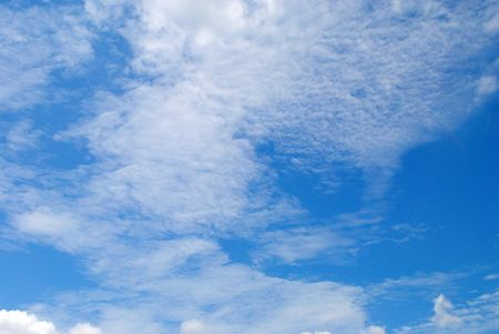 uplifting: Wisps of bright cloud in a deep blue sky