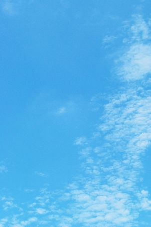 Cirrocumulus clouds in bright blue afternoon sky.