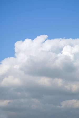 Cumulus clouds in a blue afternoon sky;background for your text